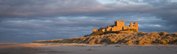 Bamburgh Castle as the Sun goes down Canvas print by Naylor's Photography
