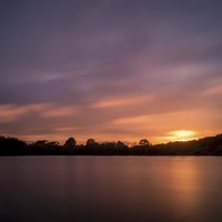 Buy canvas prints of Lake sunset by Gary Schulze