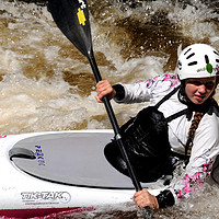 Buy canvas prints of Young female canoeist on the River Treveryn  by Harvey Hudson