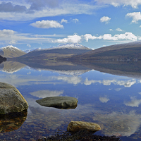 Buy canvas prints of  Winter reflections on Loch Fyne by Richard Hunt-Smith