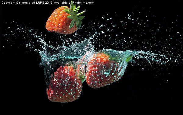 Strawberries splashed into water Canvas print by simon bratt LRPS