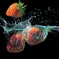 Buy canvas prints of Strawberries splashed into water by simon bratt LRPS