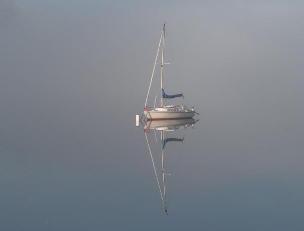 Yacht in mist Framed Print by paul green