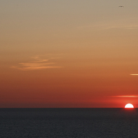 Buy canvas prints of  Cornish sunset with the sun setting into the atla by Chris Warham