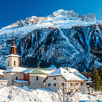 Buy canvas prints of Argentiere village and church in winter.  by Chris Warham