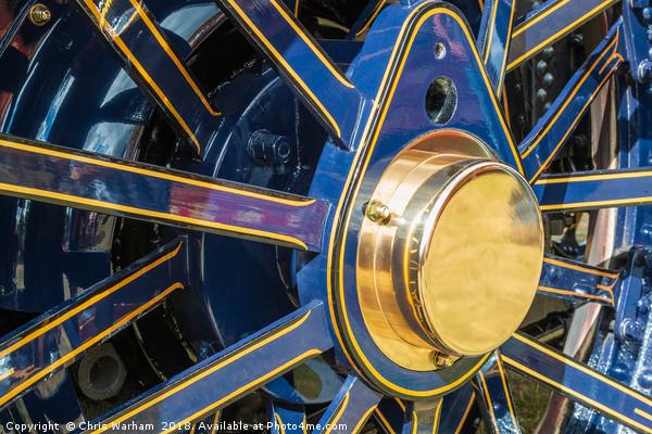 Blue and brass steam traction engine wheel Print by Chris Warham