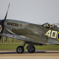 Buy canvas prints of  Spitfire Flight by Andrew Crossley