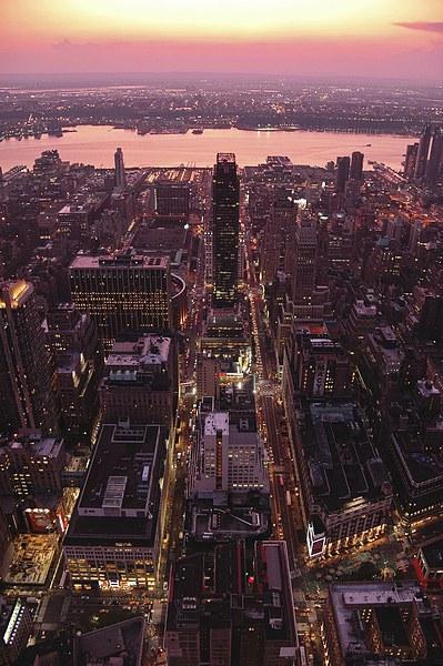 Manhattan sunset skyline Framed Mounted Print by Adam Szuly