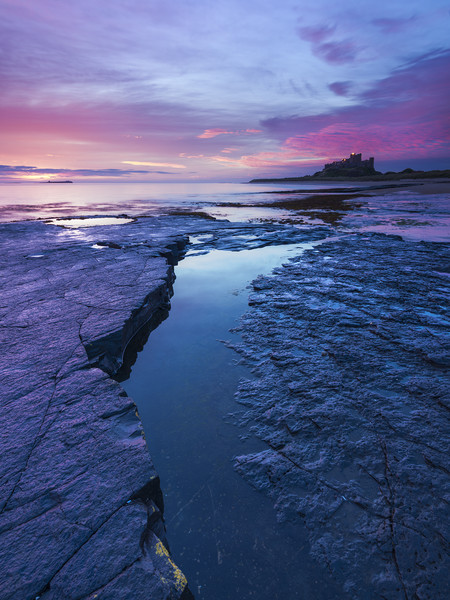 Bamburgh Rocks  Canvas print by John finney