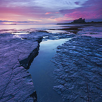 Buy canvas prints of Bamburgh Rocks  by John finney