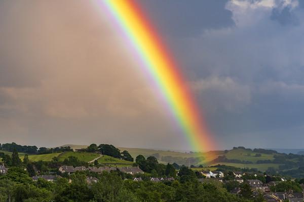 Rainbow over New Mills, Derbyshire Canvas print by John Finney