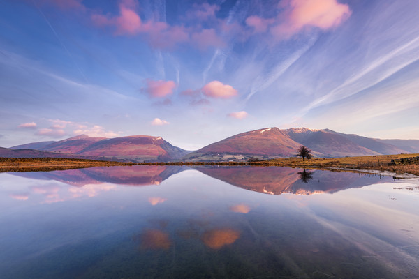 Blencathra reflecting in Tewit Tarn at sunrise Canvas Print by John Finney