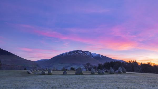 Blencathra and Castlerigg Stone Circle at sunrise Canvas Print by John Finney