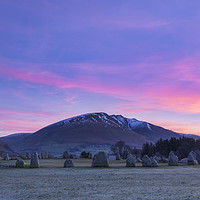 Buy canvas prints of Blencathra and Castlerigg Stone Circle at sunrise by John Finney