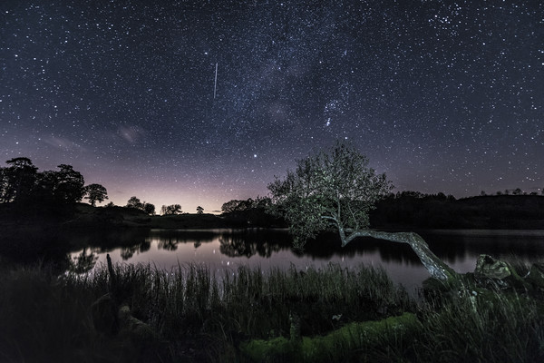 Shooting Star over Loughrigg Tarn, Ambleside.  Canvas Print by John Finney