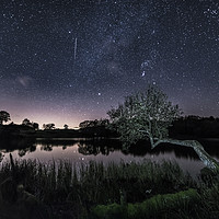 Buy canvas prints of Shooting Star over Loughrigg Tarn, Ambleside.  by John Finney