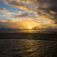 Buy canvas prints of Stormy West Kirby Marine Lake Golden Hour by David Chennell