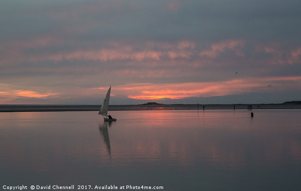 Fire Sky Sailing Canvas print by David Chennell