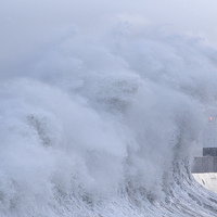 Buy canvas prints of  Porthcawl lighthouse, South Wales, UK, in a storm by Andrew Bartlett