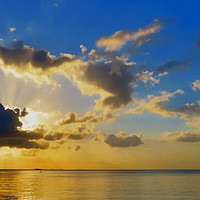 Buy canvas prints of Suns Rays over the Sea by Chloe Hull