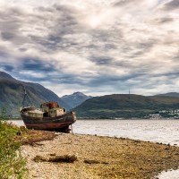 Buy canvas prints of Corpach Wreck with Ben Nevis  by Nick Rowland