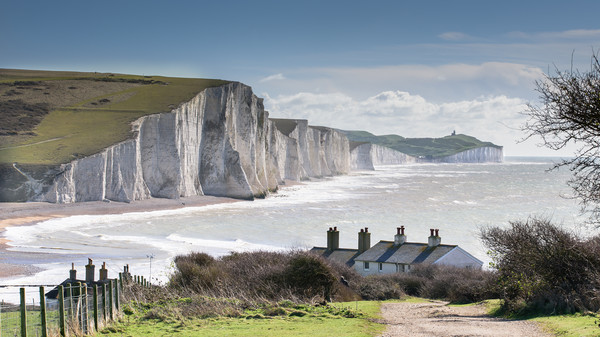 Seven Sisters and Coastguard Cottages at Cuckmere  Canvas Print by Nick Rowland