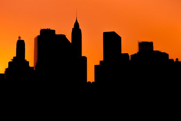Lower Manhattan Sunset Silhouette Framed Mounted Print by Johannes Valkama