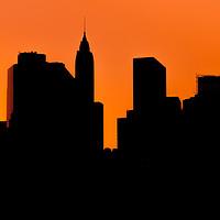 Buy canvas prints of  Lower Manhattan Sunset Silhouette by Johannes Valkama