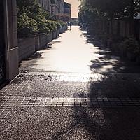 Buy canvas prints of Narrow Alley In Bright Sunlight by Jukka Heinovirta