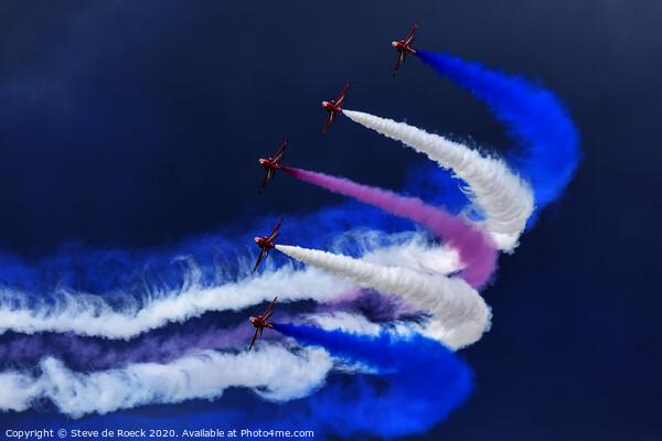 Red Arrows Trailing Smoke In A Stormy Sky. Print by Steve de Roeck