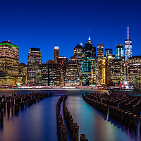 Buy canvas prints of The New York City Skyline at night from DUMBO Broo by George Robertson