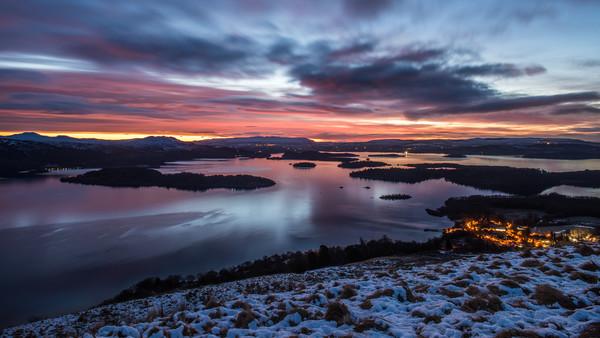 Winter sunrise on Loch Lomond Framed Print by George Robertson