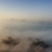 Buy canvas prints of Doha through the Morning Mists by Kasia Design