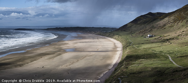 Rossili Bay with rain moving through Canvas print by Chris Drabble
