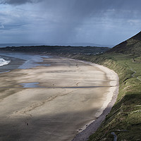 Buy canvas prints of Rossili Bay with rain moving through by Chris Drabble