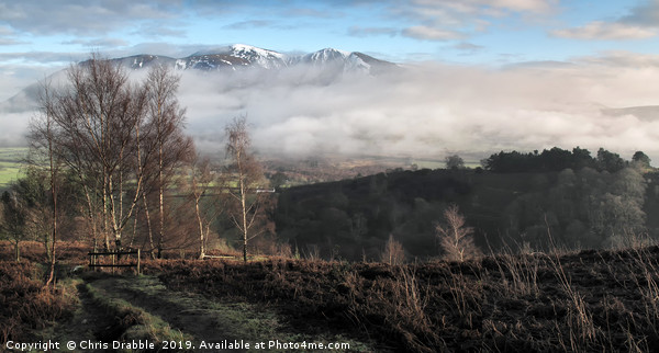A snow capped Skiddaw from Grisedale Pike Canvas print by Chris Drabble
