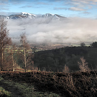 Buy canvas prints of A snow capped Skiddaw from Grisedale Pike by Chris Drabble