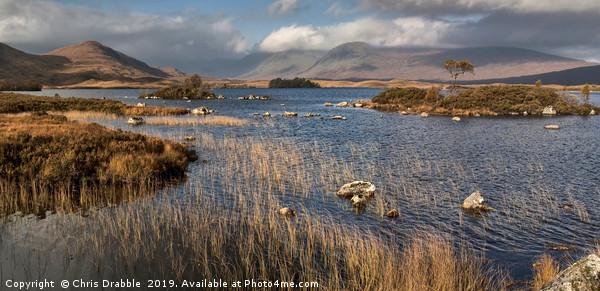 Autumn sunlight on Lochan na h Achlaise Canvas print by Chris Drabble
