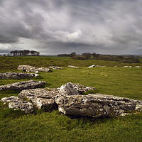 Buy canvas prints of Arbor Low under heavy skies by Chris Drabble