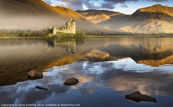 Kilchurn Castle at dawn reflected in Lock Awe Framed Mounted Print by Chris Drabble