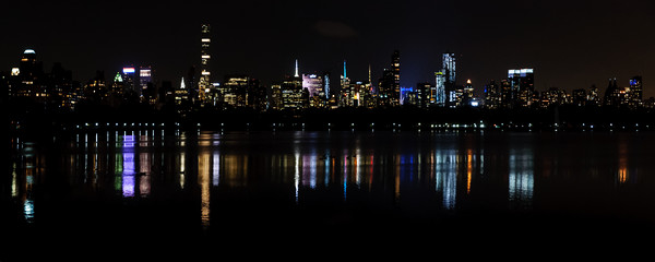 Manhattan By Night Framed Mounted Print by Mark Greenwood
