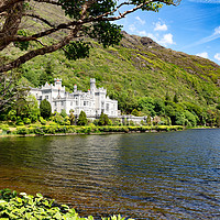 Buy canvas prints of Kylemore Abbey in Connemara mountains with lake in by Thomas Baker
