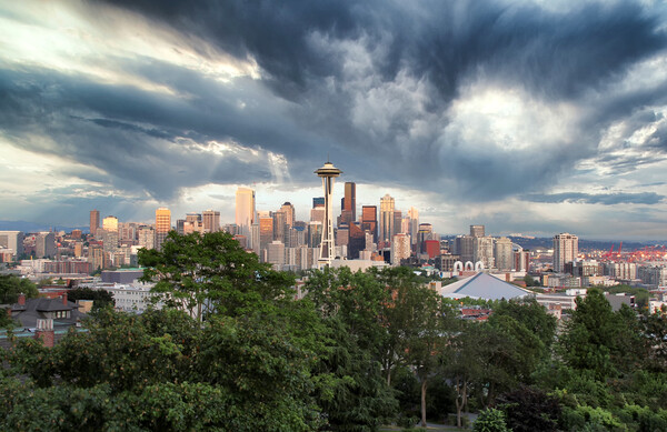 Skyline of Seattle Washington with storm approaching  Framed Mounted Print by Thomas Baker