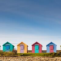 Buy canvas prints of Colourful Beach Huts at Amble by Heidi Stewart