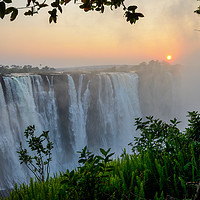 """Buy canvas prints of """"The smoke that thunders"""" - Victoria Falls sunrise by Angus McComiskey"""
