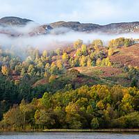 Buy canvas prints of Mist shrouded autumn colours on Loch Faskally by Angus McComiskey