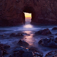 Buy canvas prints of Sunset on Arch Rock in Pfeiffer Beach, Big Sur. by Jamie Pham