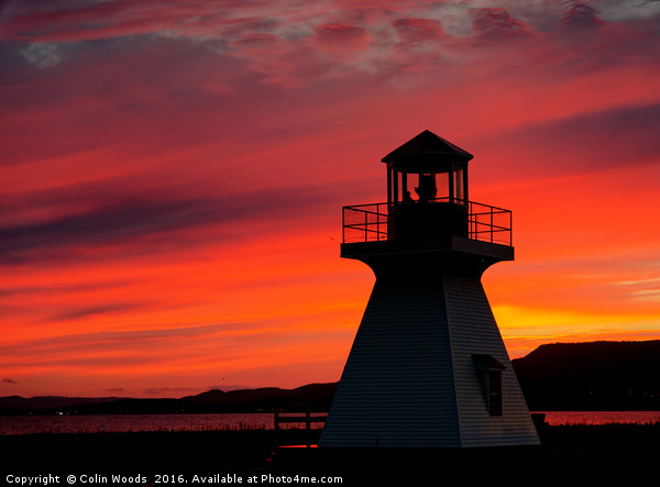 Lighthouse at Sunset Canvas Print by Colin Woods