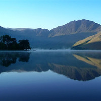 Buy canvas prints of Mountain Reflection, Buttermere by Jim Round