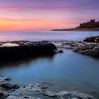 Buy canvas prints of Bamburgh Castle Sunrise, Northumberland by Jim Round